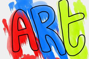 The word art painted sloppily in red, blue, and yellow.