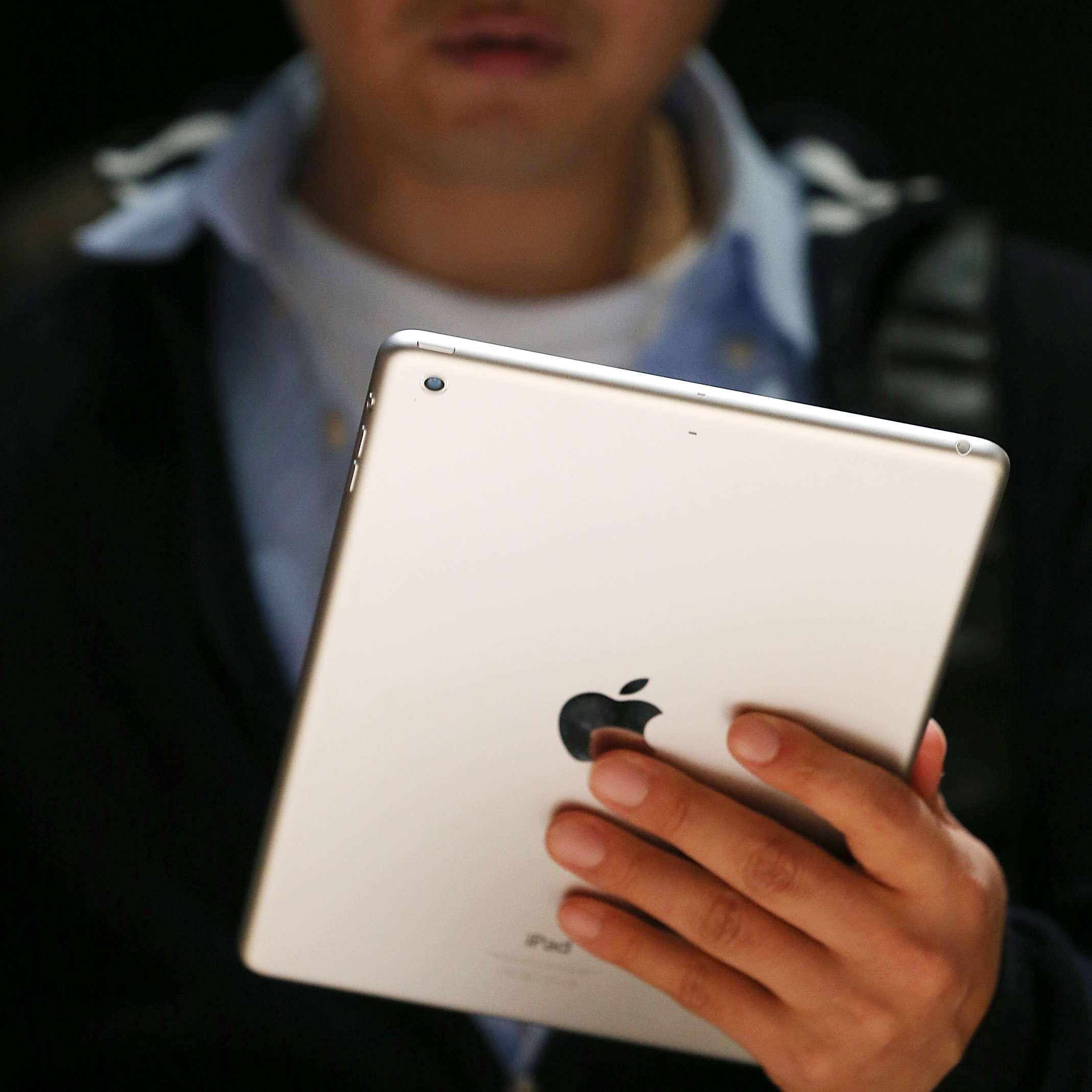 Man holding iPad air