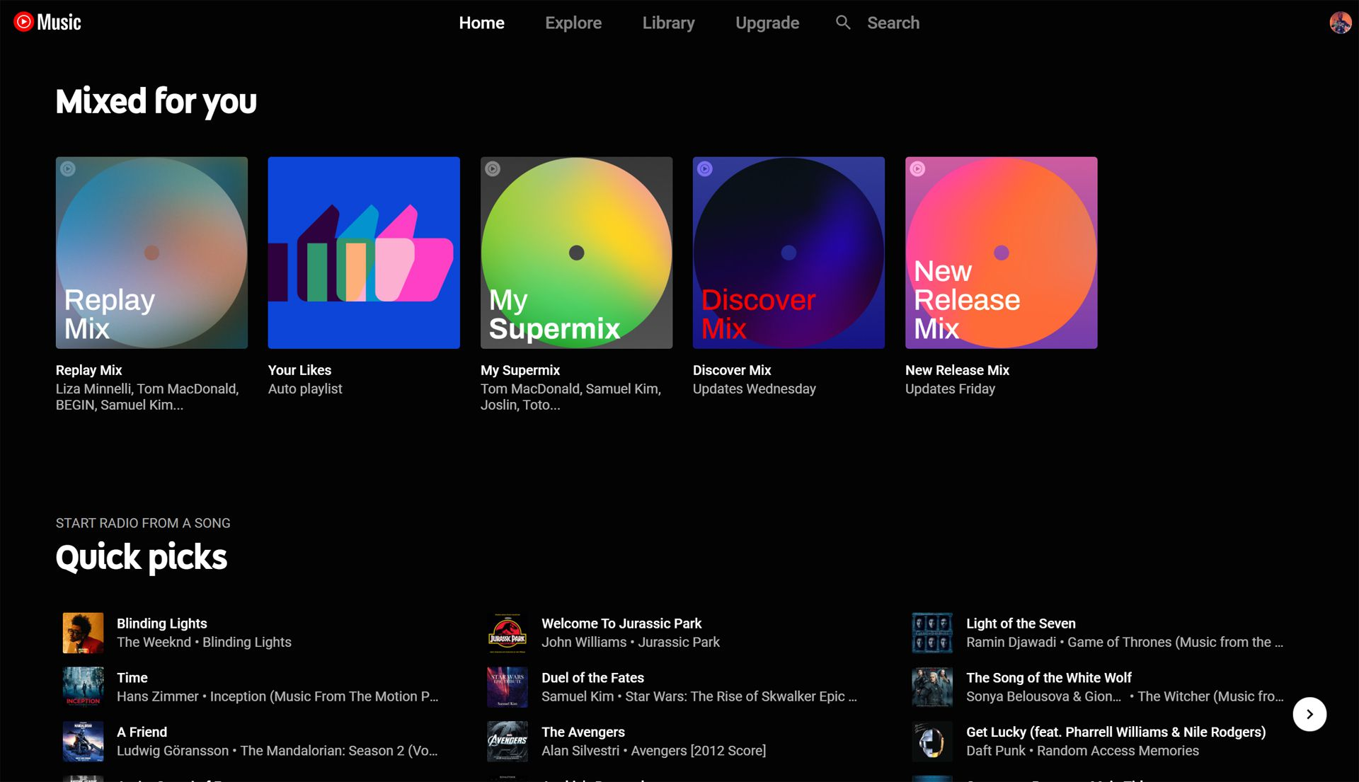 Front page of YouTube Music with Replay Mix in Mixed for you category.