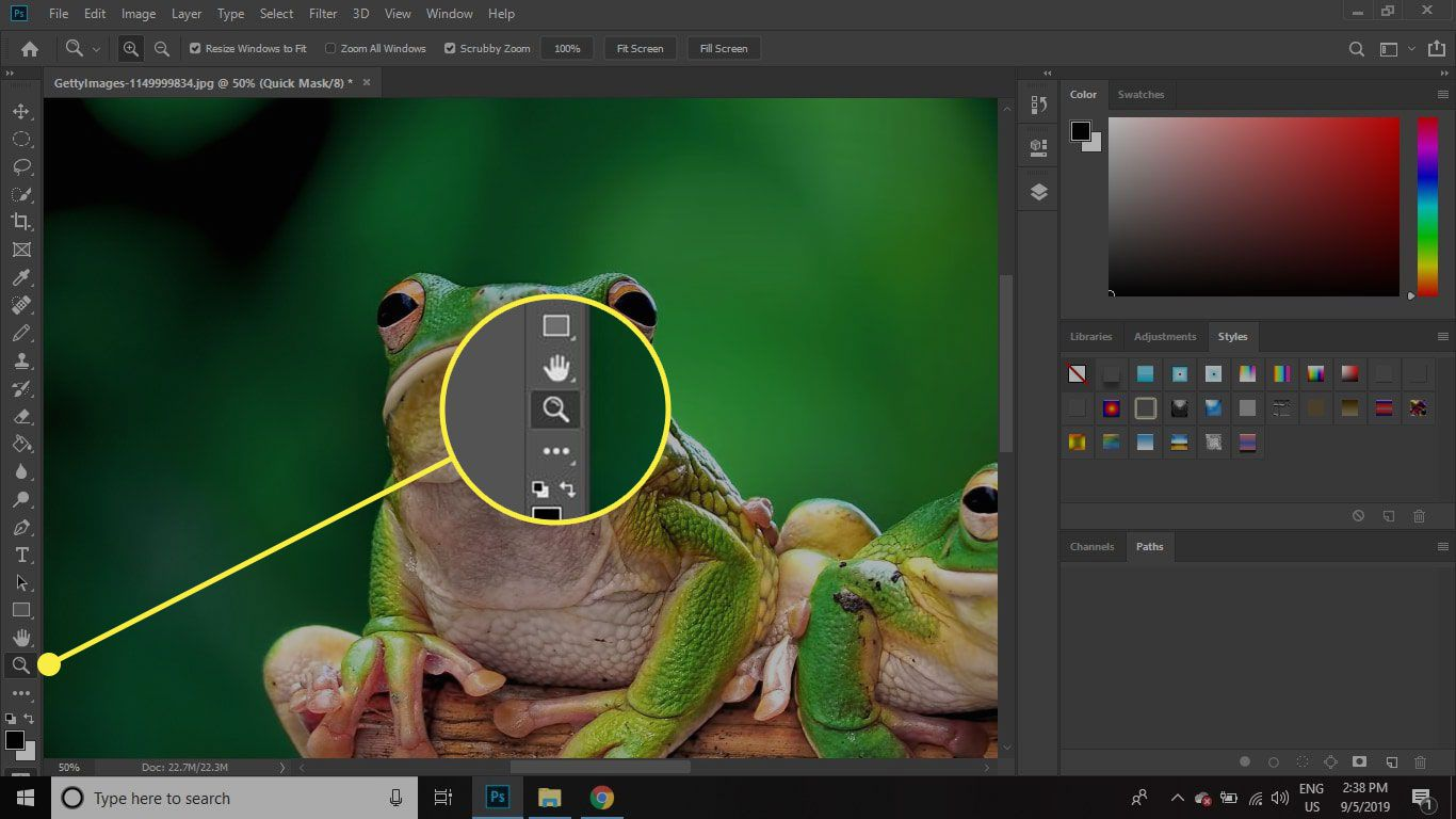 A screenshot of Photoshop with the Zoom tool highlighted