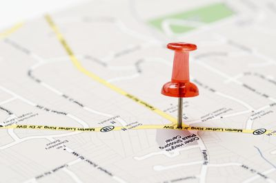 A tack on a map showing a location