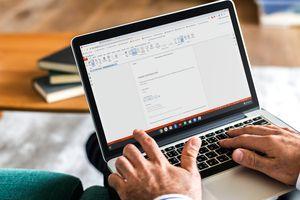 A man editing a PDF on a Chromebook.