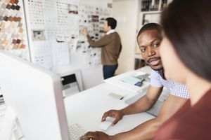 Designers reviewing ideas on desktop computer