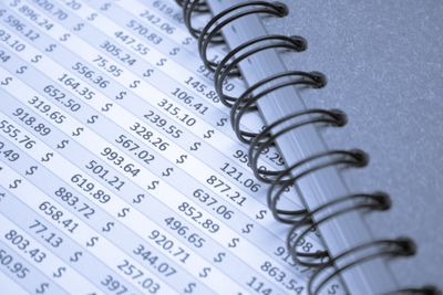 Notebook covering up financial data