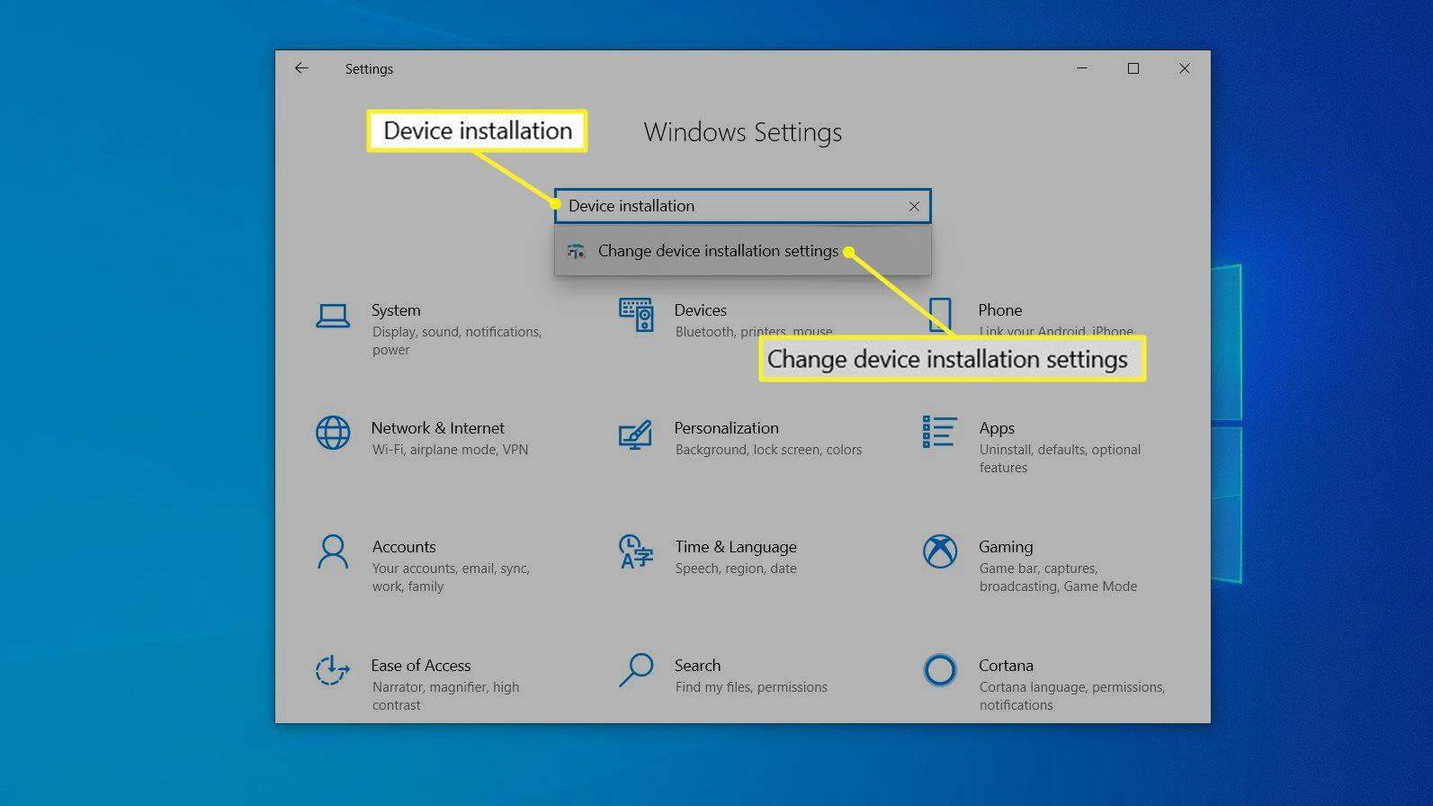 The Windows Settings dialog box with Change device installation settings highlighted