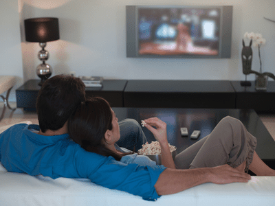 Image of a couple watching television