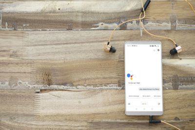 A phone sitting on a table with Google Assistant failing to play music.