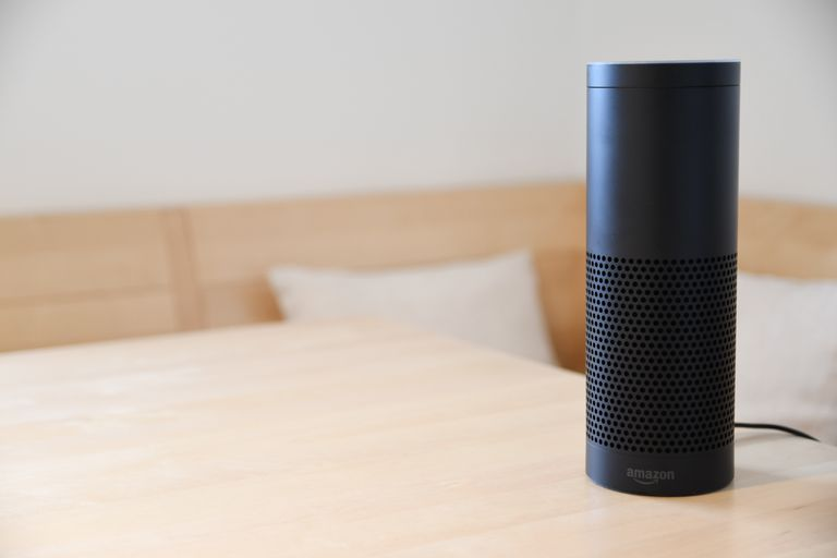 Amazon Echo atop a table.