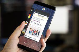 Closeup of someone taking a screenshot on a smartphone.