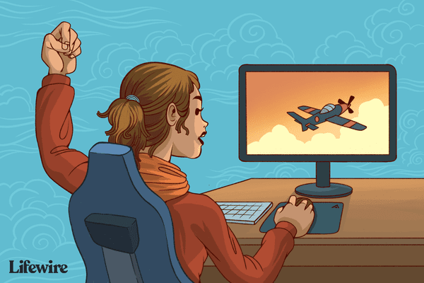 Gamer playing a flight simulator game on a computer