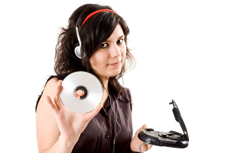 Young Girl Listening To Music On CD