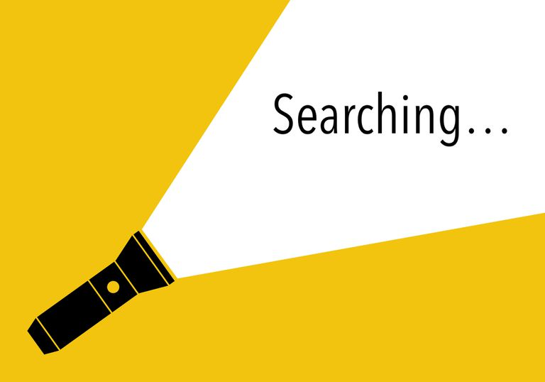 Illustration of a flashlight spotlighting the word searching...