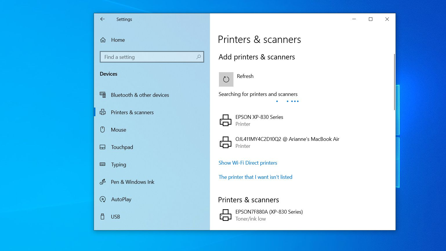 The Printers & scanners window while Windows searches for printers
