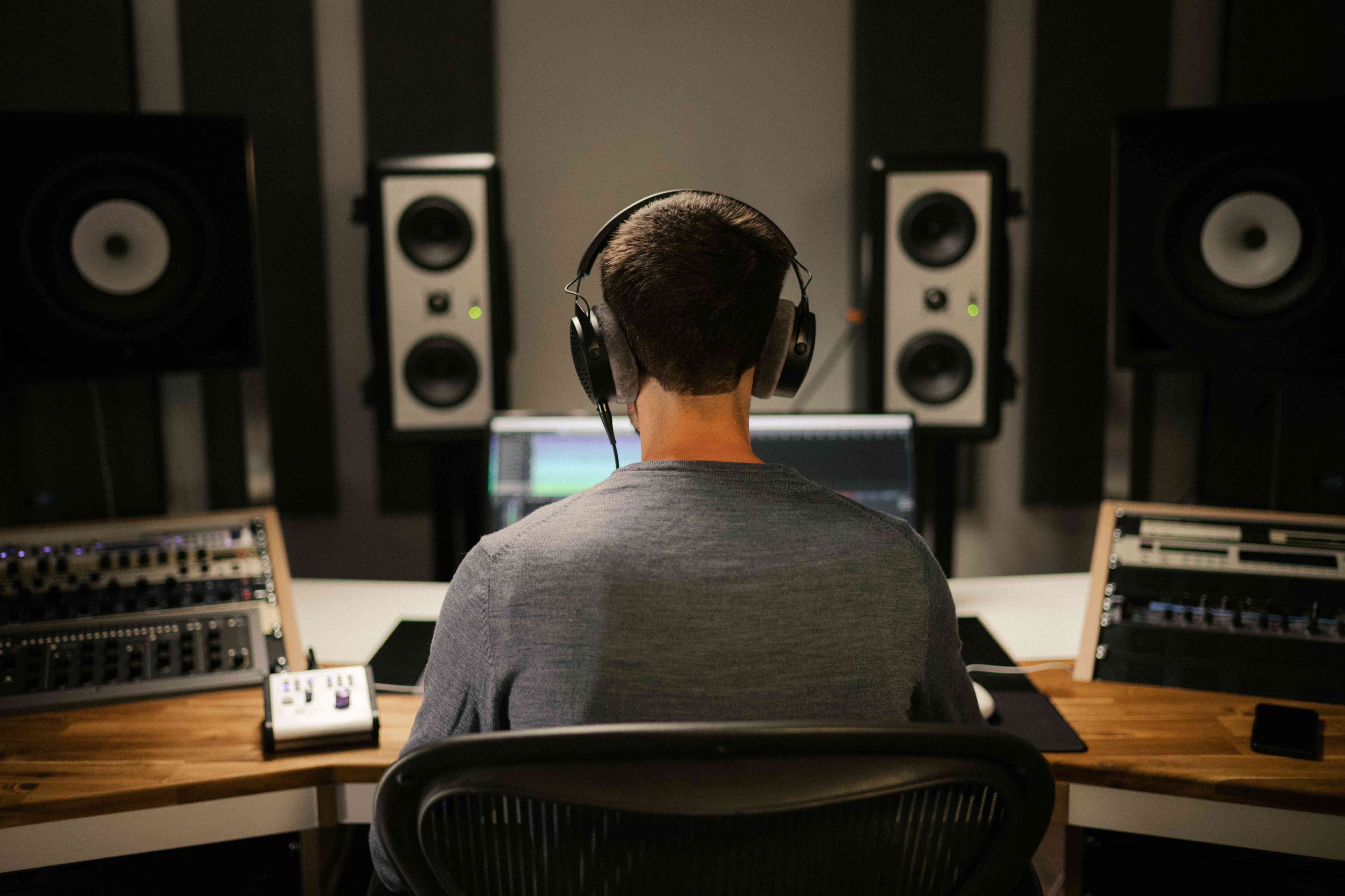 View from behind of someone using the Beyerdynamic DT 900 Pro X headphones.