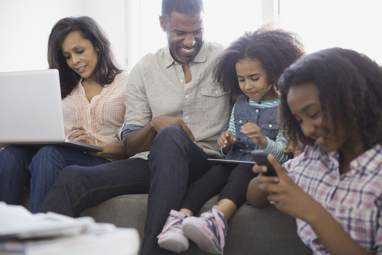 family using devices