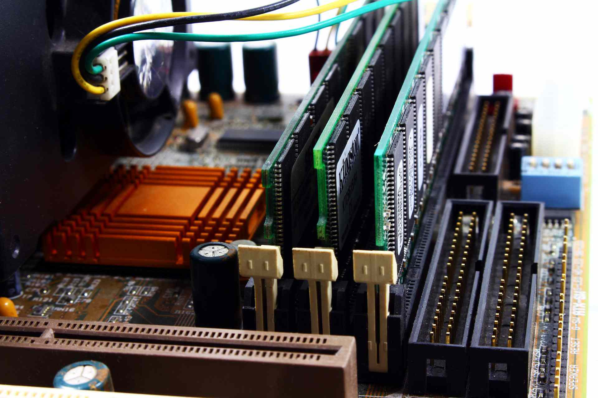 Plugging RAM modules into RAM slots in motherboard