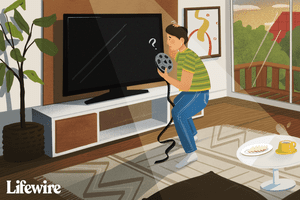 Illustration of a confused person looking for a spot to put an 8mm tape into a modern home theater system