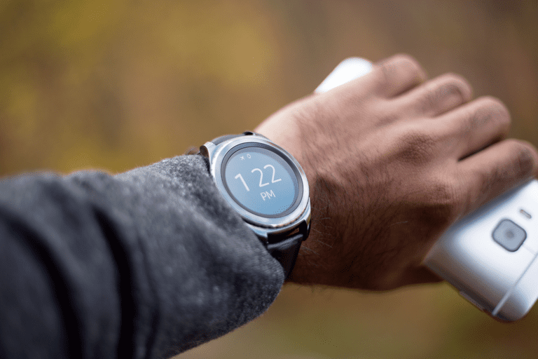 A man wearing the Samsung Gear S2 smartwatch.