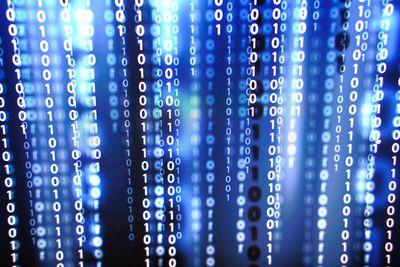 Binary code on laptop screen.