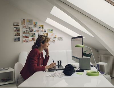 Photographer editing photos on her computer.