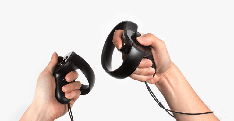 Hands holding Oculus Touch controllers