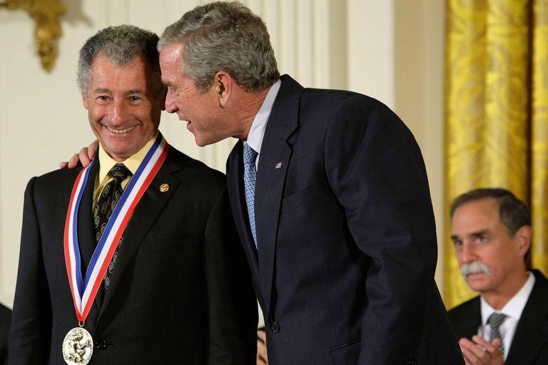 President George W. Bush (C) talks to computer scientist Leonard Kleinrock (L) after presenting Kleinrock a National Medal of Science