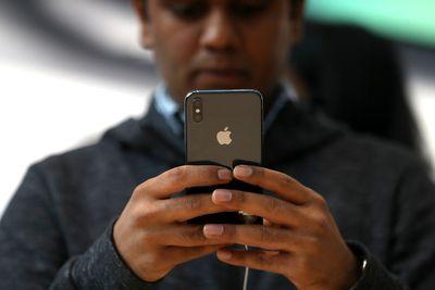 Man looking at an iPhone