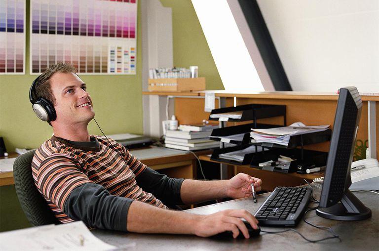 Man wearing headphones sitting at computer