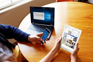 Microsoft OneDrive on a computer, tablet, and smartphone.