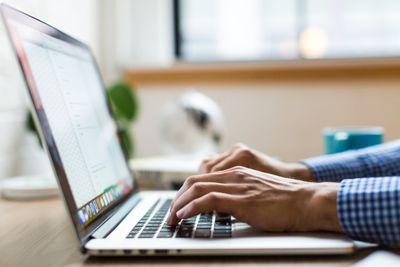 Man working on laptop on desk