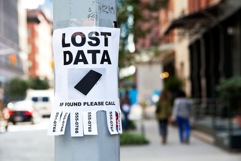 Lost Data sign taped to light post in city