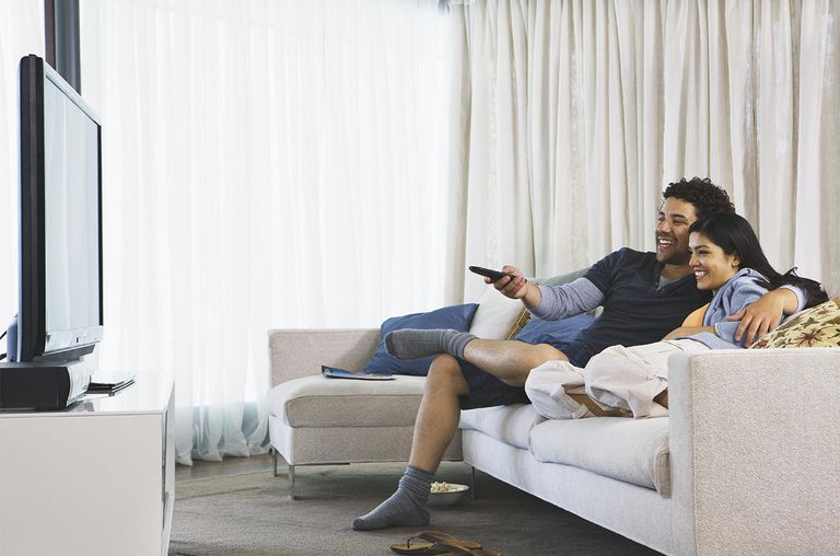 Couple watching tv in their home