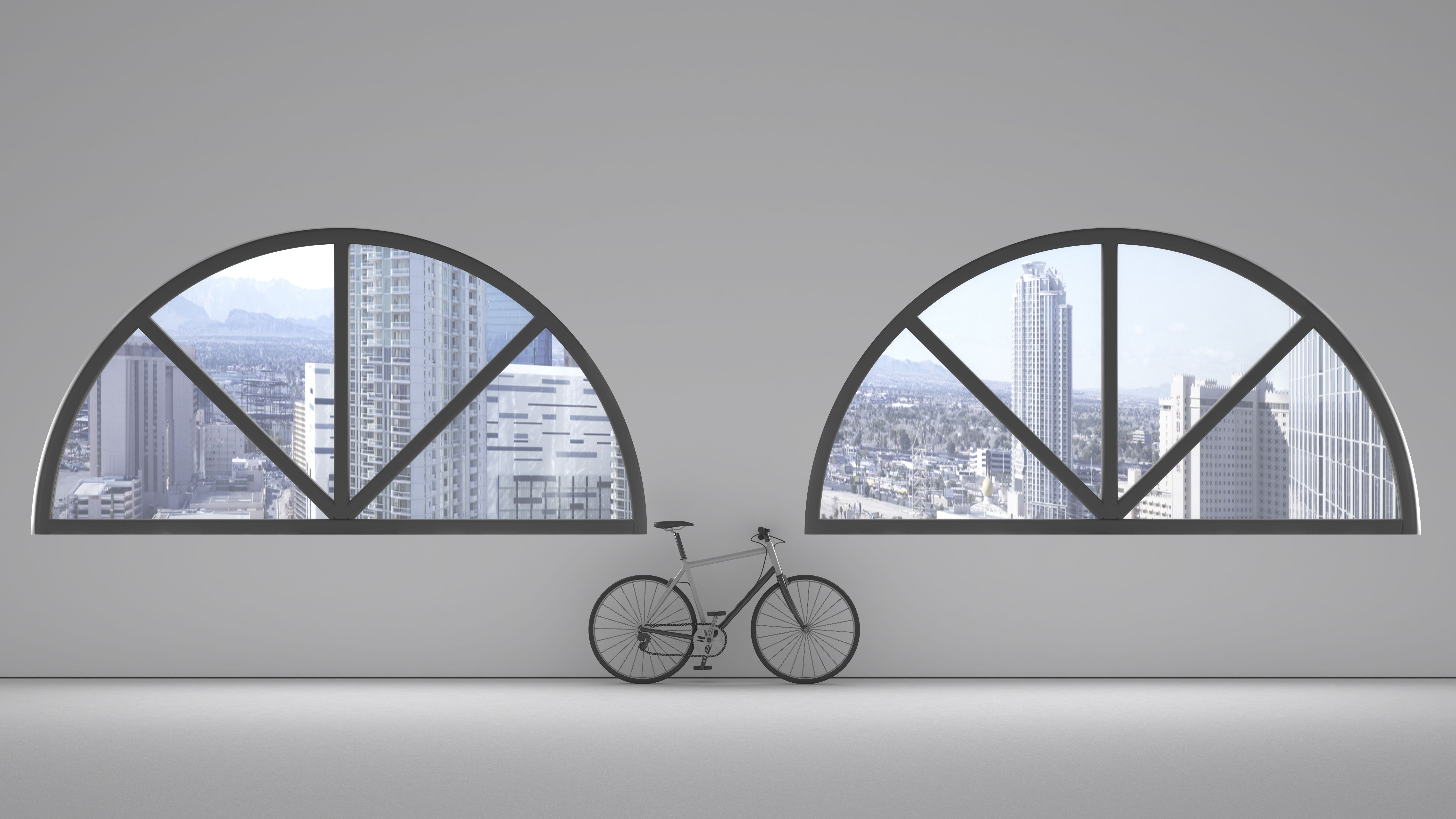 Loft with two round arch windows and bicycle leaning on the wall, 3D Rendering