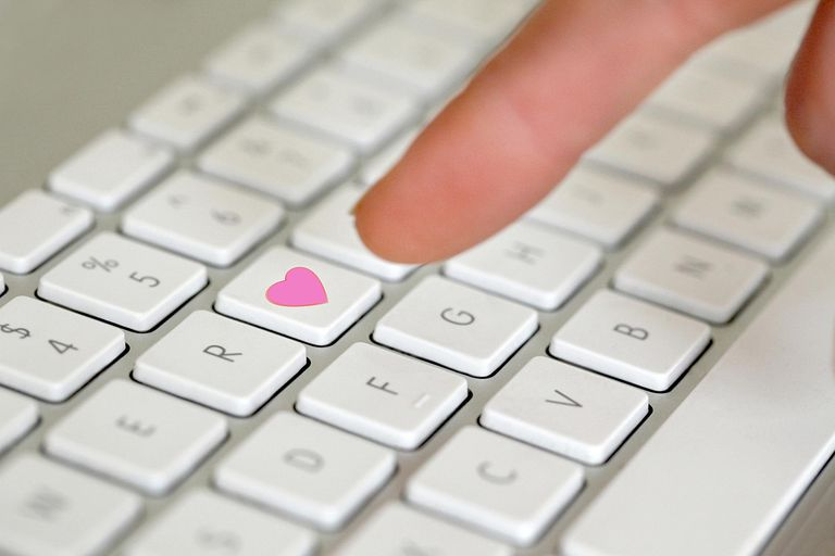 Keyboard with pink heart as a key