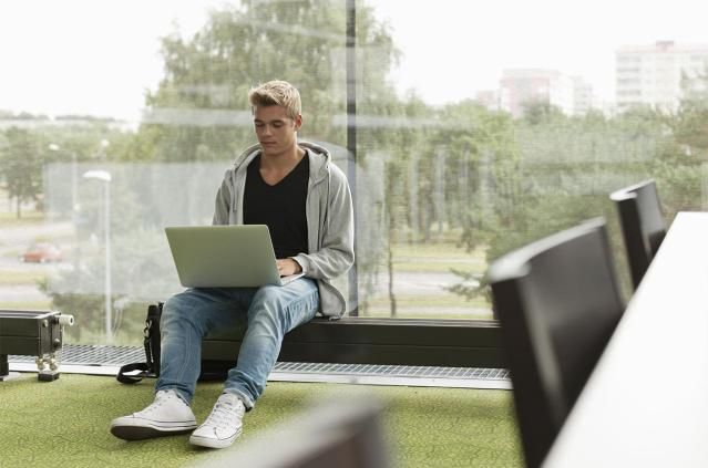 Student with laptop reading