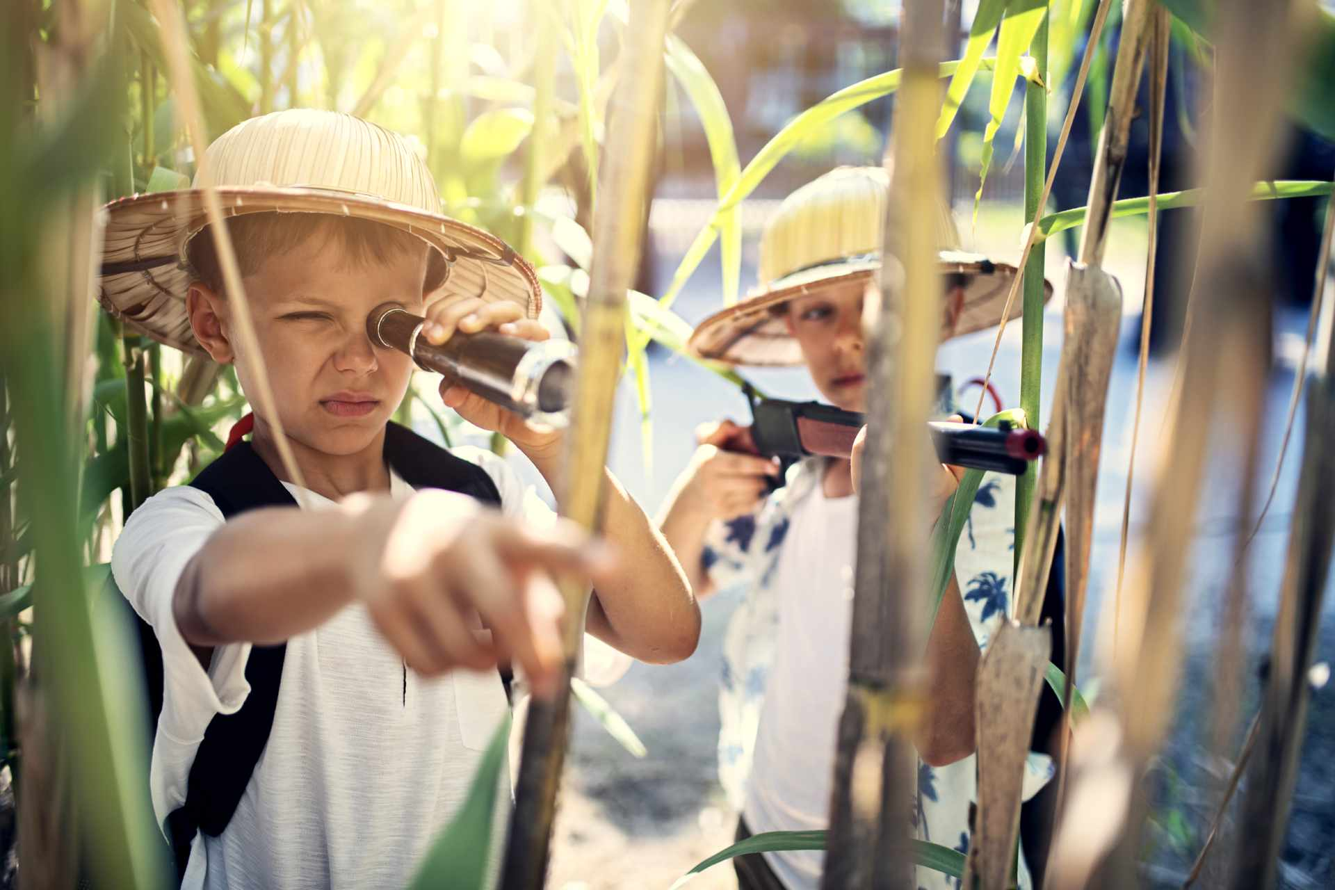 Two boys in jungle adventure gear.