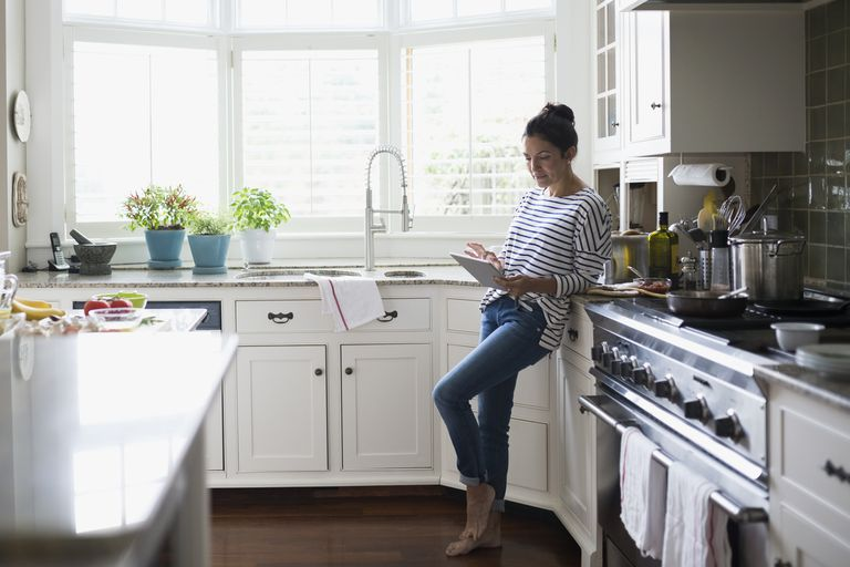 woman using ipad in the kitchen