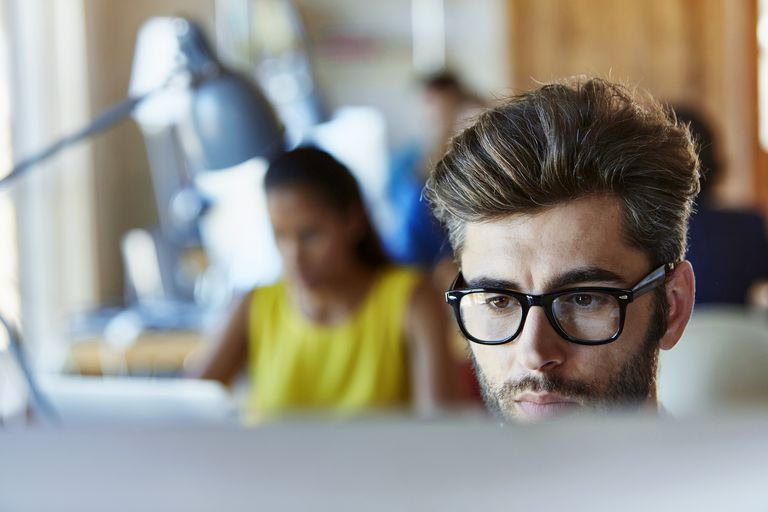 Businessman using computer in creative office