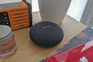 A Google Home Nest smart speaker with an alarm changing.