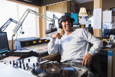 DJ listening to music in a studio