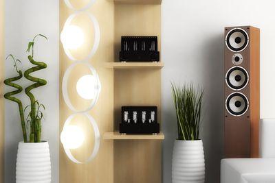 A tower speaker in modern furnished room