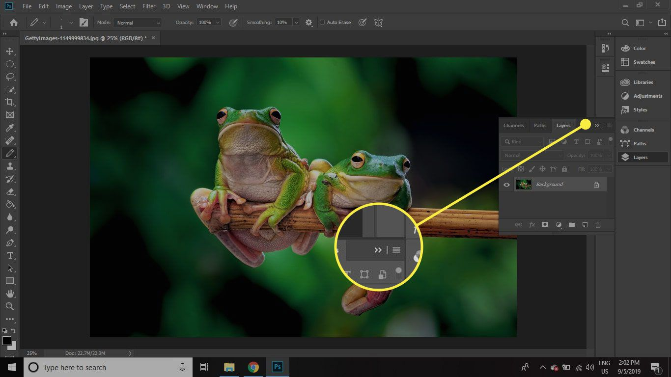 A screenshot of Photoshop with the palette collapse arrow highlighted