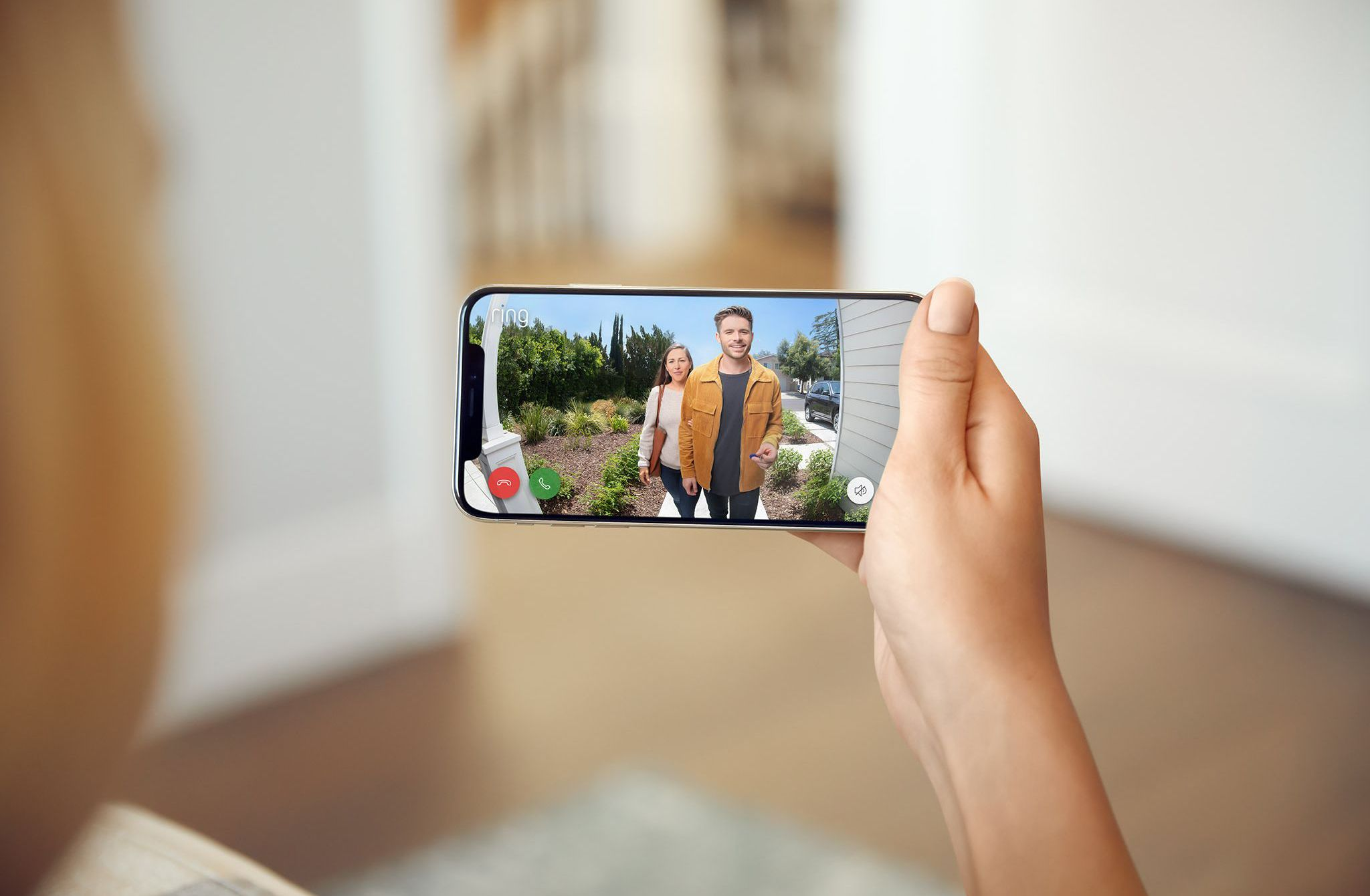 A person watching others using the Ring doorbell app on a smartphone.
