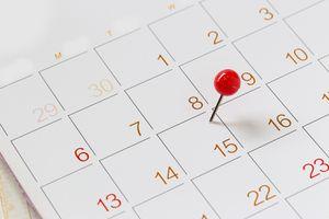 Close-Up Of Thumbtack On Calendar Date