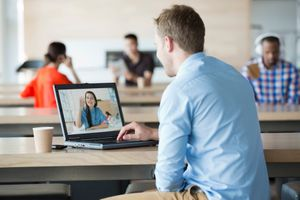 Remote worker using a laptop to have a video call with a team member