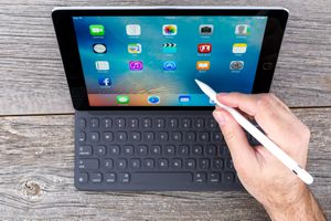 Space Grey iPad Pro Isolated on Wood And Smart Keyboard