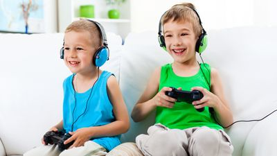 Two boys playing fun online video games on their PlayStation 4.