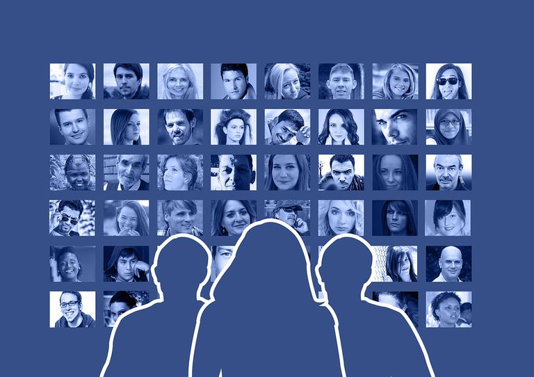 Outlined image of three people looking at a wall of photos, depicting Facebook family members