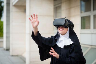A nun earing a virtual reality headset.