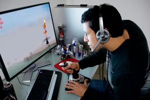 A man playing a video game on his Windows 10 computer
